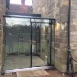 Chelwood Gate frameless glazed link incl single external lockable door